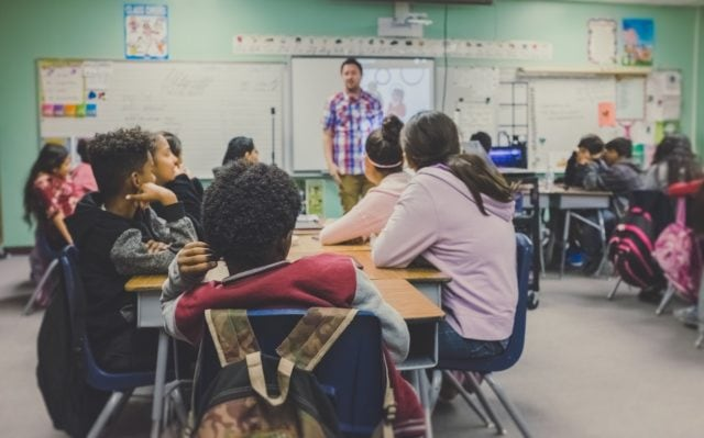 This image is used on our ultimate student loan forgiveness page as a way of showcasing a classroom where a student is teaching.